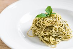 Pasta spaghetti with pesto green sauce and basil. Italian food style Royalty Free Stock Photos