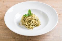 Pasta spaghetti with pesto green sauce and basil. Italian food style Stock Photos