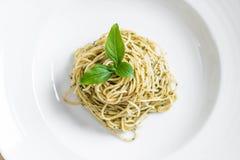 Pasta spaghetti with pesto green sauce and basil. Italian food style Stock Photo