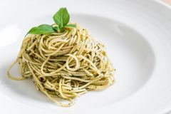 Pasta spaghetti with pesto green sauce and basil. Italian food style Royalty Free Stock Images