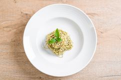Pasta spaghetti with pesto green sauce and basil. Italian food style Stock Photography