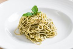 Pasta spaghetti with pesto green sauce and basil. Italian food style Royalty Free Stock Photo