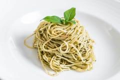Pasta spaghetti with pesto green sauce and basil. Italian food style Royalty Free Stock Image