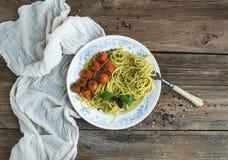 Pasta spaghetti with pesto sauce, basil, baked Stock Image