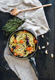 Pasta spaghetti with pesto sauce, basil, cherry Royalty Free Stock Photos