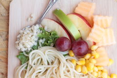 Pasta spaghetti with salad mix fruit. Royalty Free Stock Images