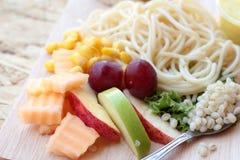 Pasta spaghetti with salad mix fruit. Royalty Free Stock Photo