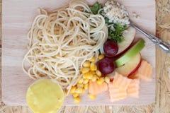 Pasta spaghetti with salad mix fruit. Stock Photography