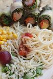 Pasta spaghetti with salad mix fruit and vegetables Stock Image