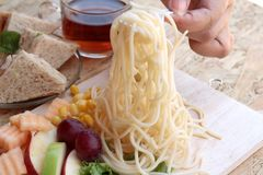 Pasta spaghetti with salad mix fruit and vegetables Stock Images