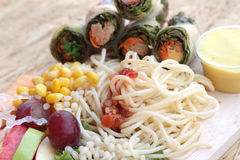 Pasta spaghetti with salad mix fruit and vegetables Stock Photography