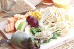 Pasta spaghetti with salad mix fruit and vegetables Royalty Free Stock Images