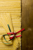 Pasta spaghetti tied with ribbons of the flag colors of Italy Royalty Free Stock Photography