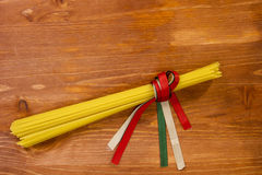 Pasta spaghetti tied with ribbons of the flag colors of Italy Royalty Free Stock Image