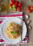 Pasta spaghetti with tomatoes and Basil on a white plate on the Royalty Free Stock Image