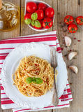 Pasta spaghetti with tomatoes and Basil on a white plate Royalty Free Stock Photography