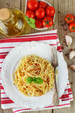Pasta spaghetti with tomatoes and Basil on a white plate Royalty Free Stock Images