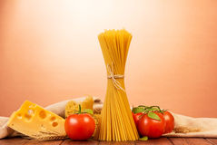 Pasta spaghetti with tomatoes and cheese on  pink background. Royalty Free Stock Photography