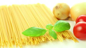 Pasta spaghetti tomatoes onion and basil, italian food background stock footage