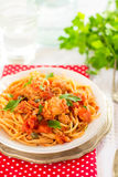 Pasta spaghetti with tuna, capers in tomato sauce Royalty Free Stock Photos