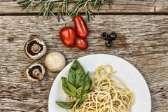 Pasta. Spaghetti. Vegetables. Spices.top view Stock Image