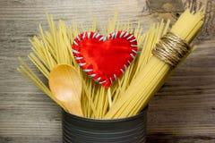 Pasta Spaghetti and wooden spoon Royalty Free Stock Photo