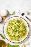 Pasta spaghetti with zucchini top view. royalty free stock image