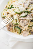 Pasta ( spaghetti ) with zucchini, mushrooms, creamy sauce and parmesan Royalty Free Stock Photography