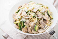 Pasta ( spaghetti ) with zucchini, mushrooms, creamy sauce and parmesan Royalty Free Stock Photos