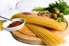 Pasta and spices. Spices and sauce for cooking on a white background Royalty Free Stock Image