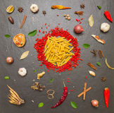 Pasta with spices on background for cooking. Stock Images