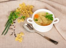 Pasta, spices, greens and soup in a cup Royalty Free Stock Photography