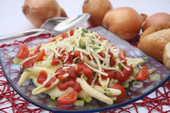 Pasta with spices and tomatoes Stock Images