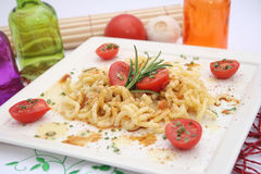 Pasta with spices and tomatoes Stock Photo