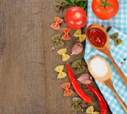Pasta, spices and vegetables Stock Images