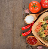 Pasta, spices and vegetables Royalty Free Stock Photography