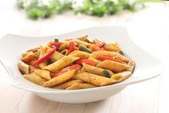 Pasta with spicy pepper sauce. Penne pasta cooked with spicy pepper sauce with vegables Stock Image
