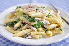 Pasta with spinach and bacon Stock Photography