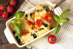Pasta with spinach and cheese. Pasta casserole in ceramic dish Stock Photo