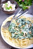 Pasta with spinach and feta cheese. In plate Royalty Free Stock Image