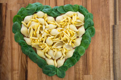 Pasta and spinach heart. Stock Photo