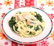 Pasta with spinach and salmon fish Royalty Free Stock Images