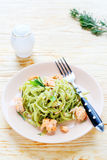Pasta with spinach and salmon slices Stock Photography