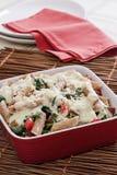 Pasta with spinach tomato and garlic cream Stock Image