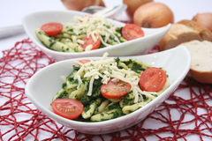 Pasta with spinach and tomatoes Stock Photography