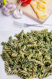 Pasta with spinach Stock Image