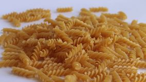 Pasta spiral falls back stock footage