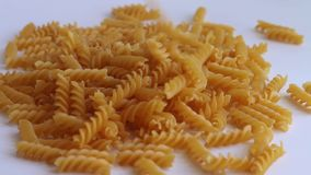 Pasta spiral falls white background stock video footage