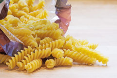 Pasta  in spiral shape fall out of a bag Stock Images