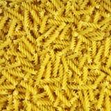 Pasta spirals Background Stock Photos